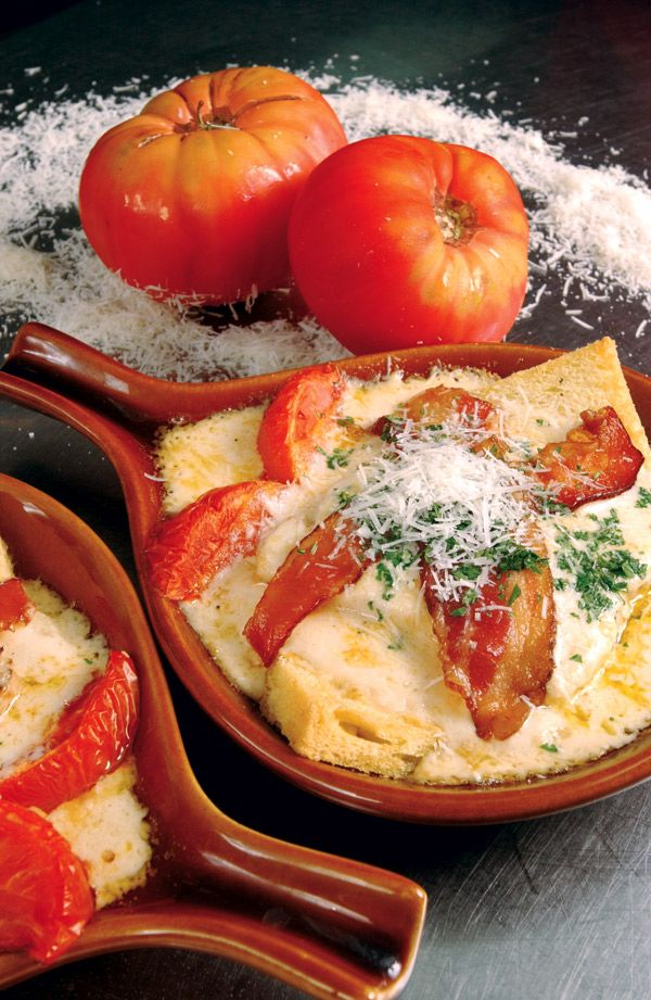 The Hot Brown is a Kentucky classic created in the 1920's at Louisville's Brown Hotel.  It is an open face sandwich of turkey, bacon, tomato, and Mornay sauce. Link to the authentic Brown Hotel recipe.