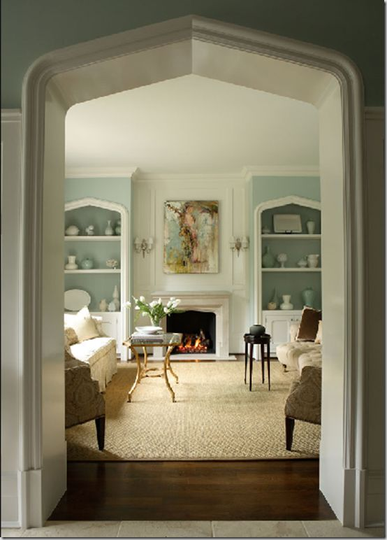 Living Room With Tudor Arches On The Fireplace Door And