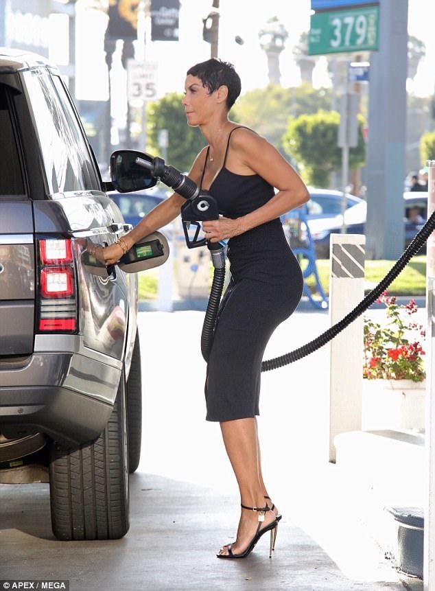 Nicole pumping gas milf