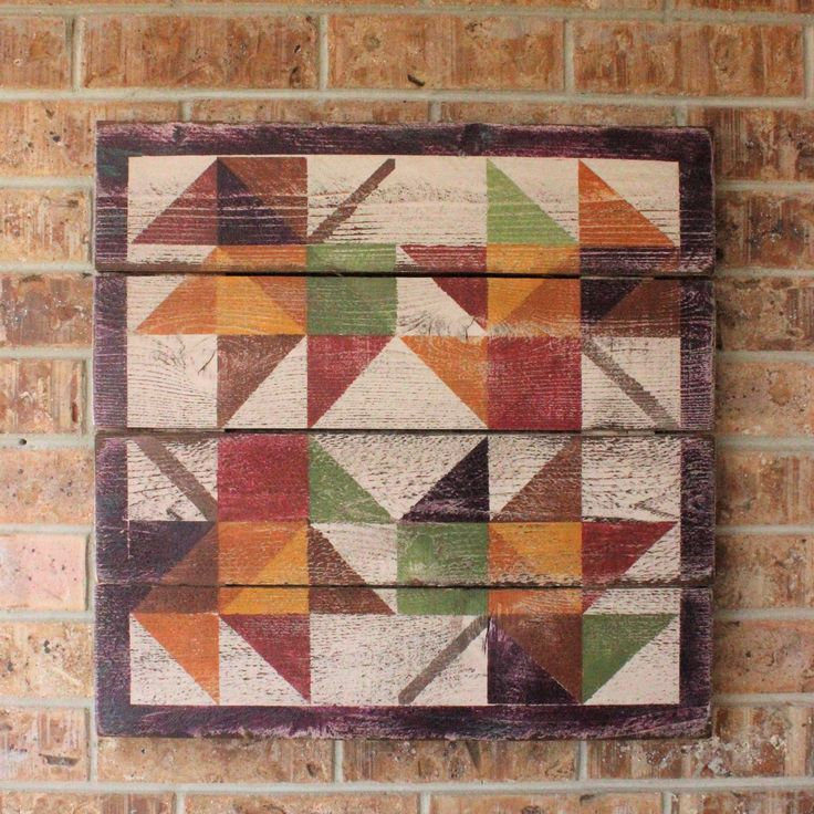 "A colorful hand painted barn quilt distressed and sealed for indoor or outdoor use. Available in three sizes 22"", 33"" and 44"". Custom colors available through email request."