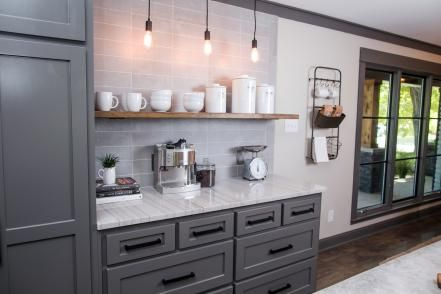 The kitchen also includes this coffee bar with gray tile backsplash, storage draweres, floating shelf and accent pendants with vintage style bulbs.