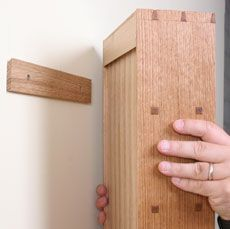 How to Hang a Cabinet on the Wall - Fine Woodworking Article. Or, y'know, the OMFG Tall Bookshelves Of Wonder. Else what's a 12' ceiling for?