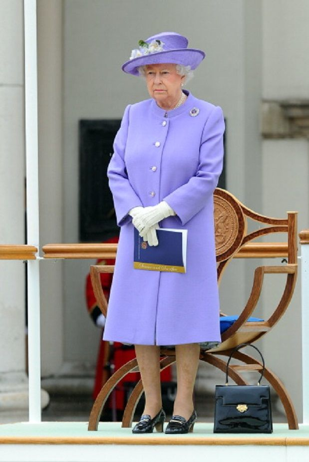Queen Elizabeth II wearing a Stewart Parvin lilac double crepe wool coat with a funnel collar, Stewart Parvin floral print dress and hat by Rachel Trevor-Morgan with flowers in it to match, as she attends the Solemn Drumhead service at Royal Hospital Chelsea, 28.06.2014 in London, England.