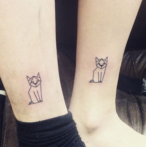 Simply and geometrically strictly made cat tattoos on both ankles.