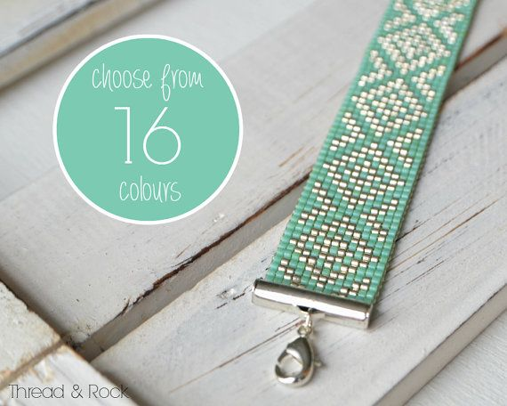 CUSTOM DESIGN bracelet featuring Japanese Miyuki delica beads, hand-woven using a bead loom. Bracelet shown in picture uses Sea Green and Silver coloured beads. MATERIALS - Miyuki duracoat delica beads in a choice of 16 colours - Miyuki duracoat delica beads in Galvanised Gold or Galvanised Silver - Gold/ Silver-plated findings - Thread & Rock jewellery tag The delica beads used in this piece are produced with Duracoat® (a durable clear coating that is thicker and stronger than traditiona...