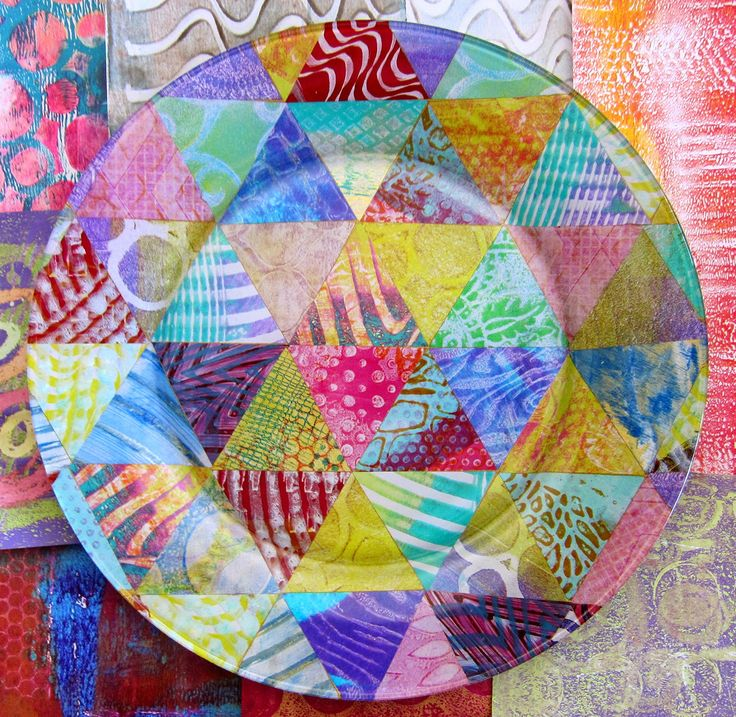 Reverse Decoupage Tutorial with Gelli® Plate Prints! While sorting through the cut shapes and images, I became intrigued with the idea of arranging and collaging them onto the back of a glass plate — a process called 'reverse decoupage'.