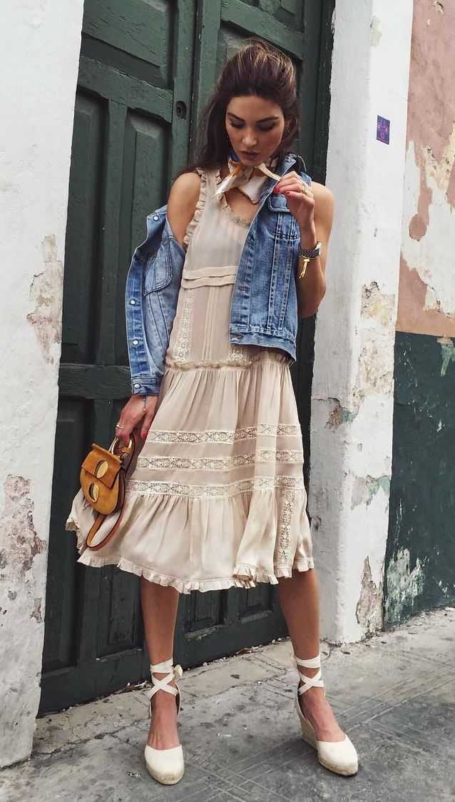 A frilly dress paired with a denim jacket and lace-up espadrilles.