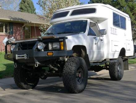 1985 Toyota Hilux 4x4 diesel pickup with a Chinook camper shell