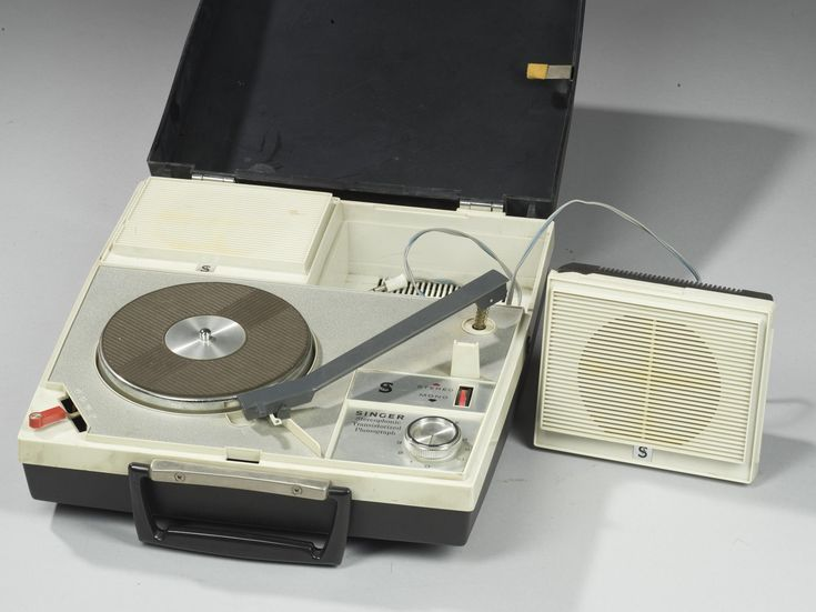 Portable stereo record player made in Japan for the Singer Company.