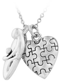 I found this beautiful necklace love the Autism puzzle pieces with mother .