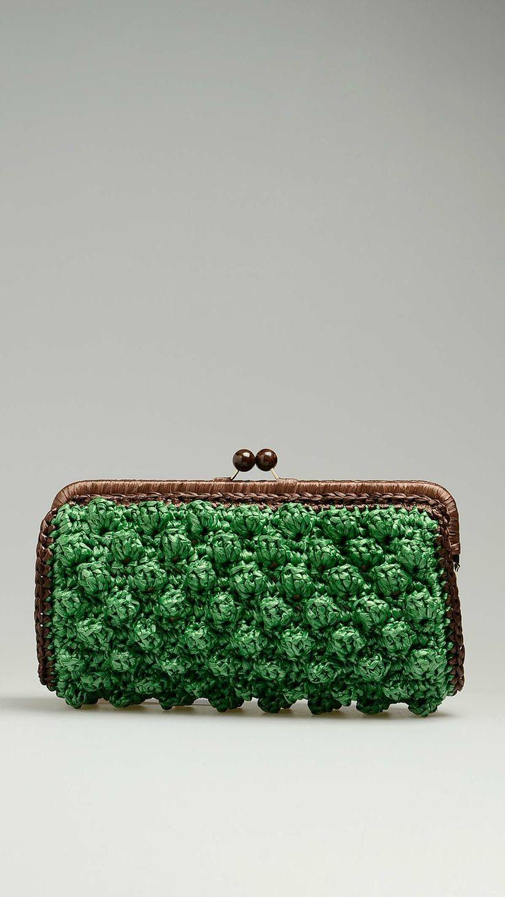 Green rafia bag featuring hazelnut stitch detail, dark chocolate trim, brown plexiglass boule clasp, stripes pattern inner lining featuring a zip pocket, 11'' x 2.8'' x 6'', 100% raffia.