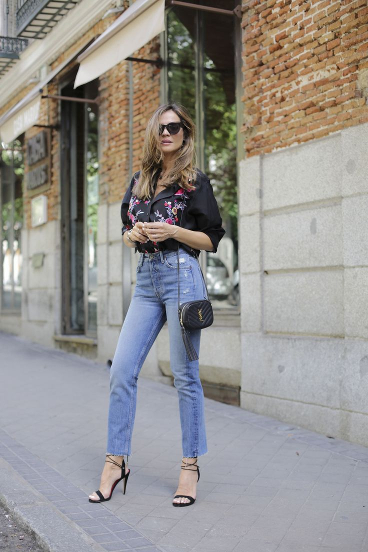 flower embroidered shirt looks - Lady Addict. Black flower embroidered shirt+jeans+black lace-up heeled sandals+black tassel short crossbody bag+sunglasses. Spring Dressy Casual Outfit 2017