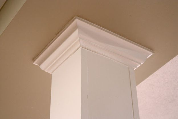 Use molding to turn basement pillars into beauty