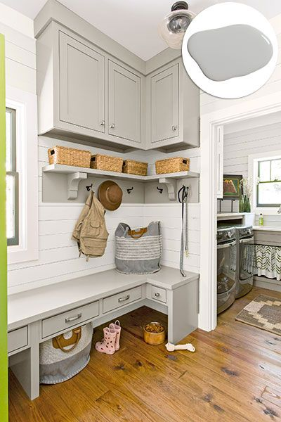 A custom built-in bench houses drawers for nicknacks and space underneath for just-shed shoes. Additional cabinets and hooks organizes inhabitants of all ages and sizes. Paint: Olympic's Stormy Weather (cabinets)Ceiling light: Lamps PlusBags, pet accessories: The Company Store