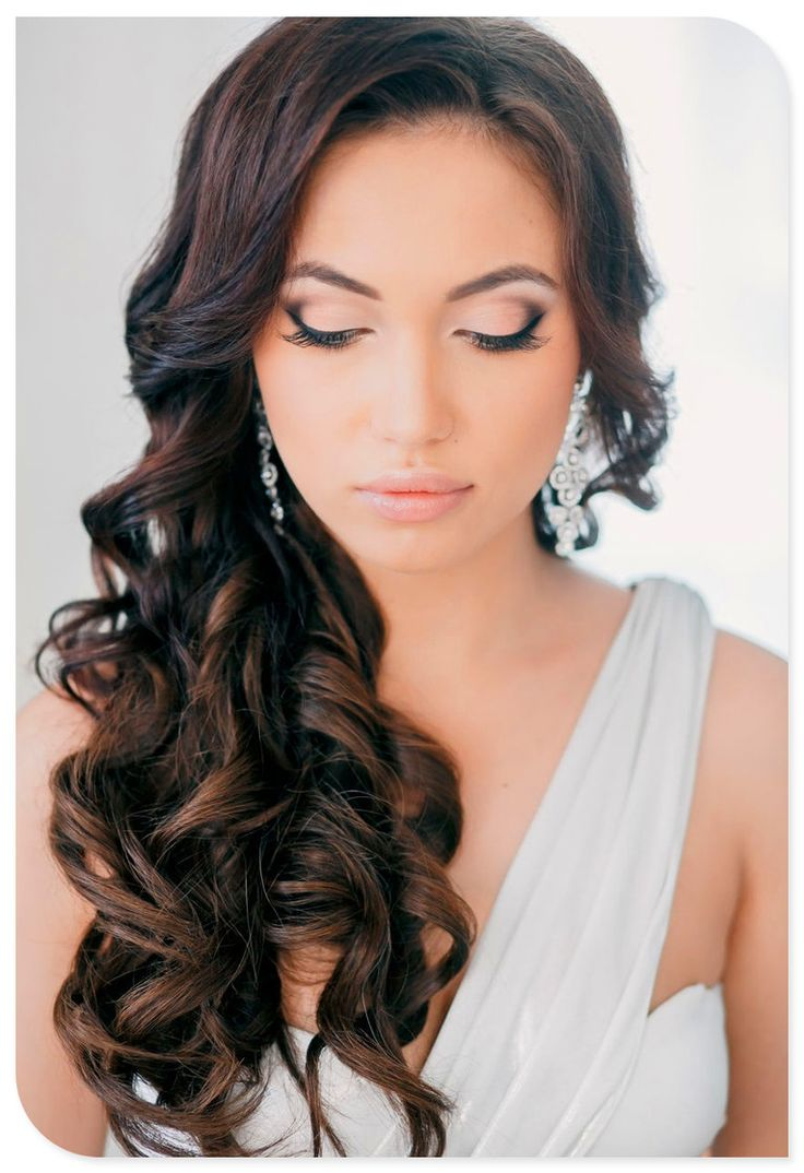 Hair: Cascading curls on one side. Makeup: Soft, pinky/peach, dark only in outer v.