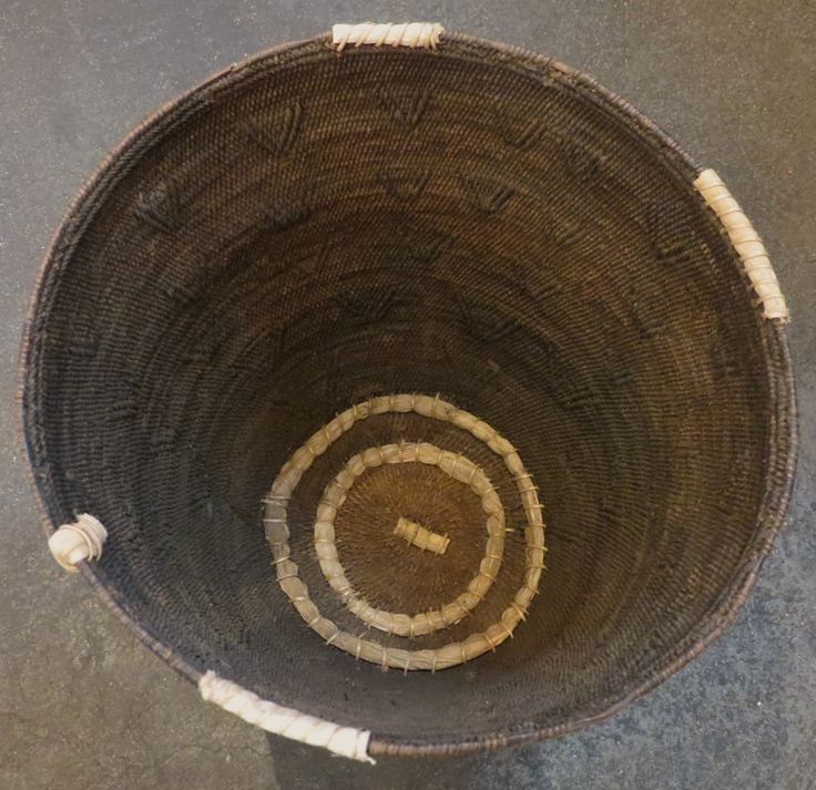 Beautifully woven and much-used old African storage basket. Lozi People, Zambia at Kim Sacks Gallery Johannesburg