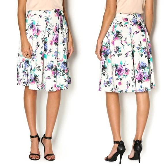 "Floral Skirt The Flower Midi skirt is your go-to girly skirt. This feminine skirt features a 2"" elastic waistband and inverted box pleats. Tuck in a fun fuchsia or lilac tank to highlight the floral in this beauty. Fits true to size. M Fits US size 6/8 Skirts A-Line or Full"