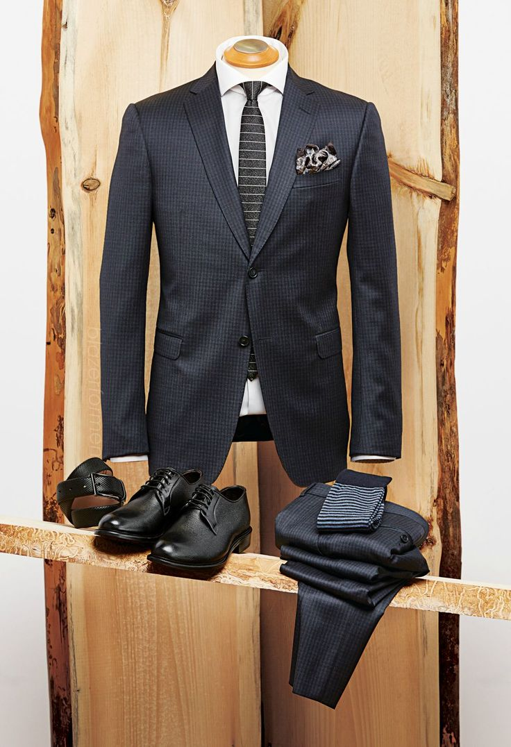 The Broker Z Zegna check suit - Mexico Boss silk tie - Italy Eton herringbone shirt - Romania Boss laser scale leather belt - Italy Eton pocket square - Italy Giulio Moretti pebbled leather shoes - Italy Marcoliani wool socks - Italy