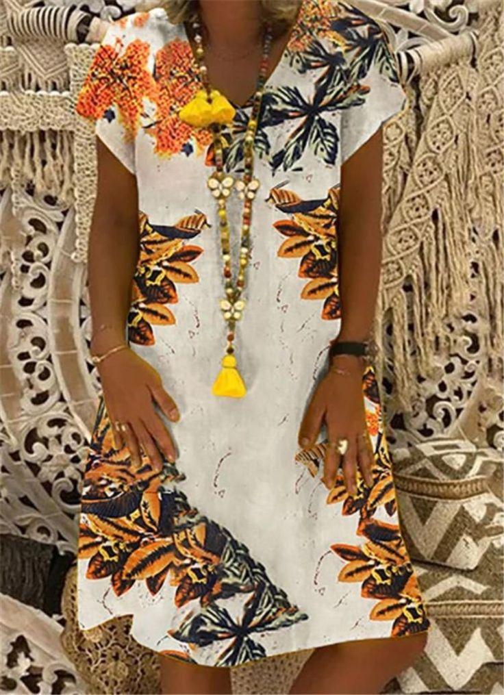 Ich fand dieses erstaunliche böhmische Blumendruck-Kurzarm-Kleid mit V-Ausschnitt