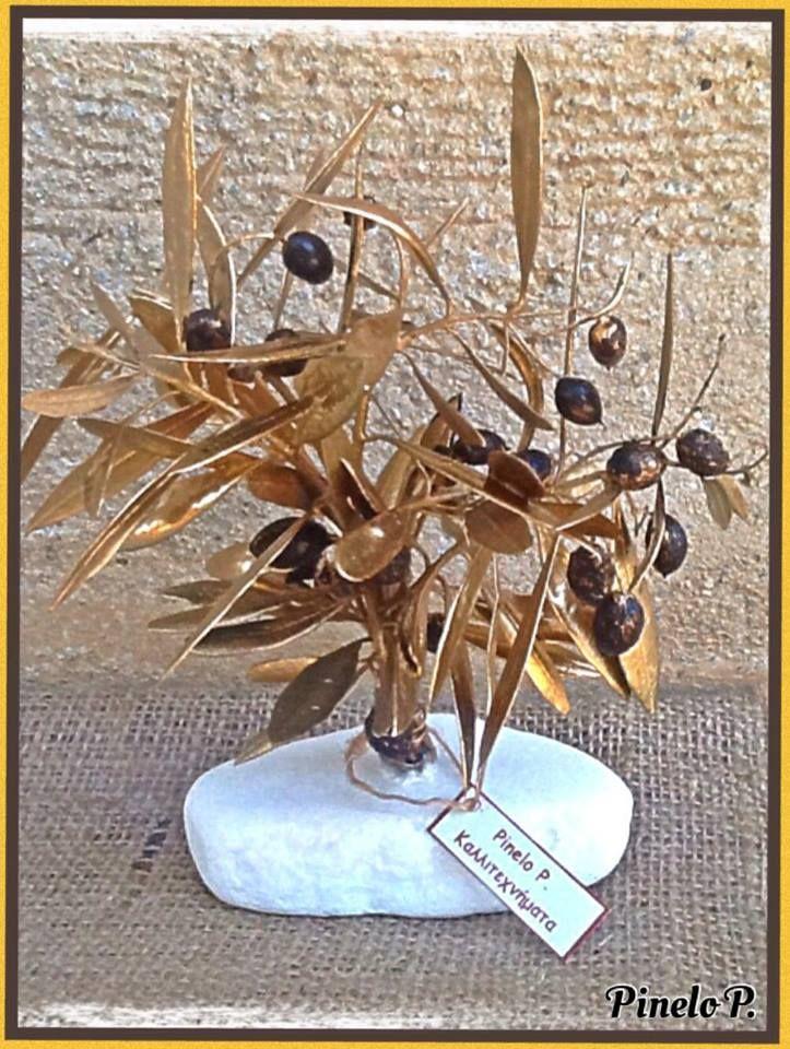 Small olive tree on white stone www.facebook.com/pinelokallitexnimata