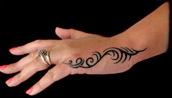 hand tattoo | tribal motif on the a woman's left hand