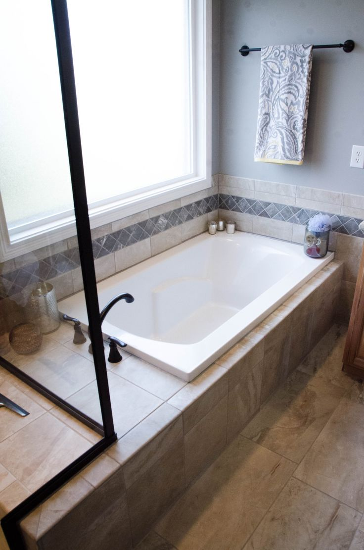 Drop-in soaker tubs are usually deck mounted with tile splash all the way around.
