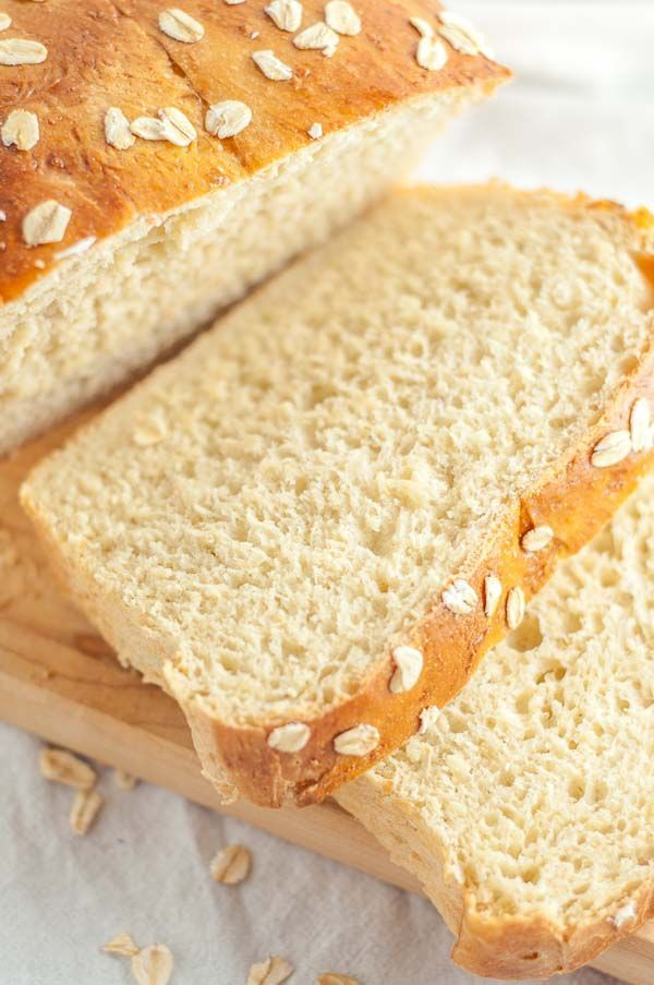 This Honey Oatmeal Bread recipe is an all-time favorite! It's light, airy, a touch sweet, and has a spongy crumb. It is an absolute perfect bread recipe! www.mamagourmand.com