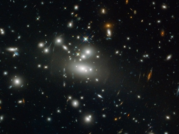 This fascinating space wallpaper shows galaxy cluster Abell S1077, as seen by the NASA/ESA Hubble Space Telescope's Wide Field Camera 3 and the Advanced Camera for Surveys. The cluster acts as a magnifying glass, its gravity high enough to warp even the fabric of space-time.