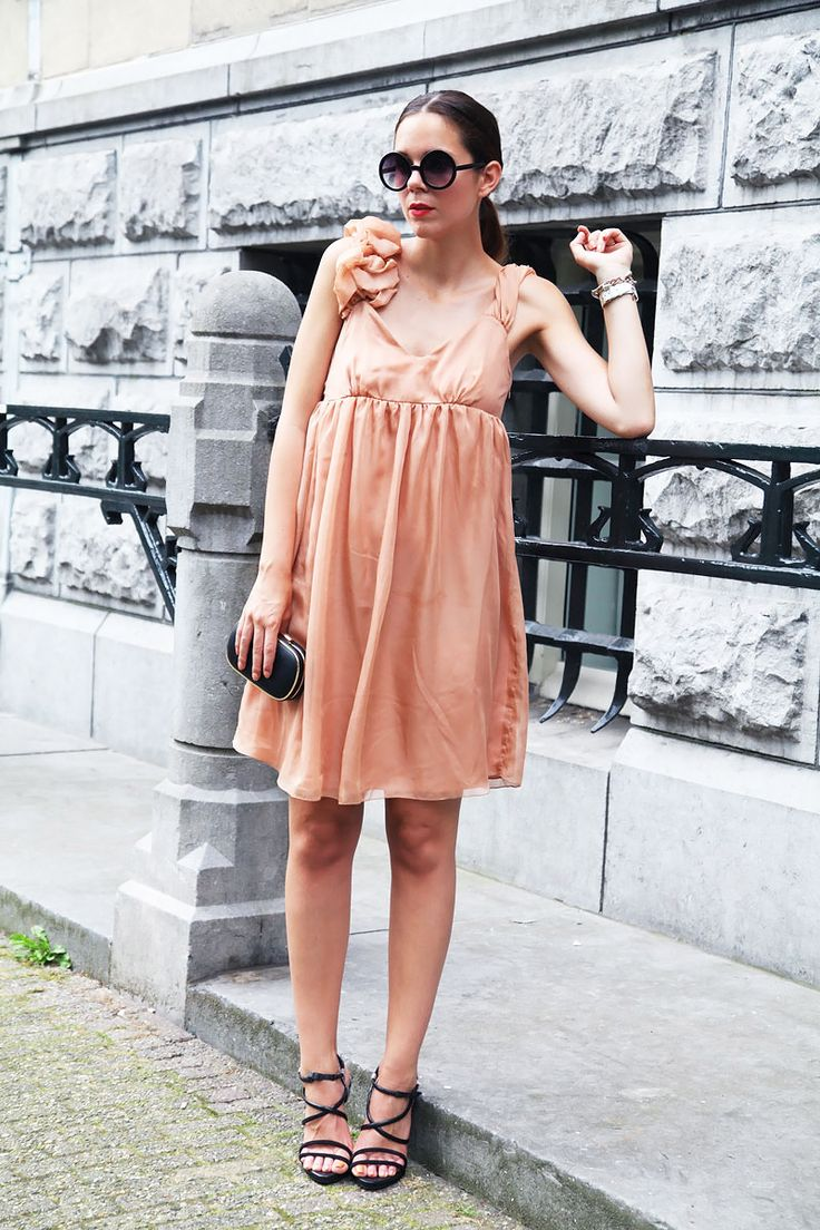 Wearing a peach coloured silky dress with black accessories today. The perfect springtime look for smart occasions!