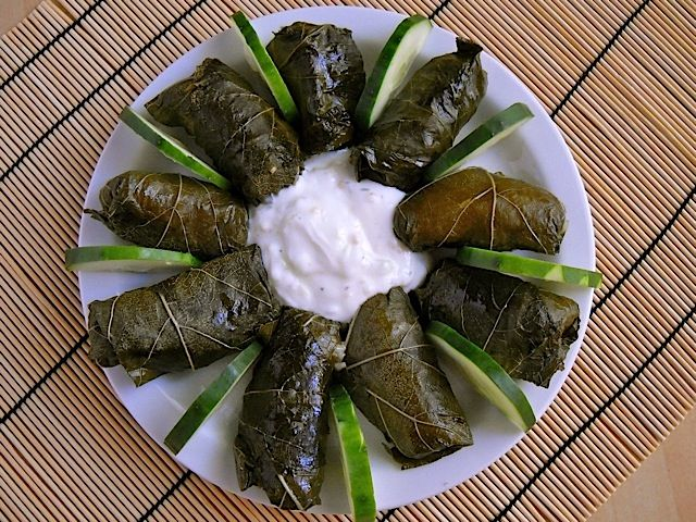 Dolmas--filling needs a little something more, but otherwise, these were actually worth the time, unlike other (disastrous) recipes I've tried.