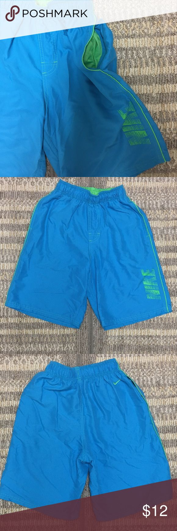 Nike Swim Trunks Nike Swim Trunks in Size Medium. Light blue color with Nike symbol on the back and Nike Logo on front and green underwear. Worn only twice but still in good condition. Nike Swim Swim Trunks