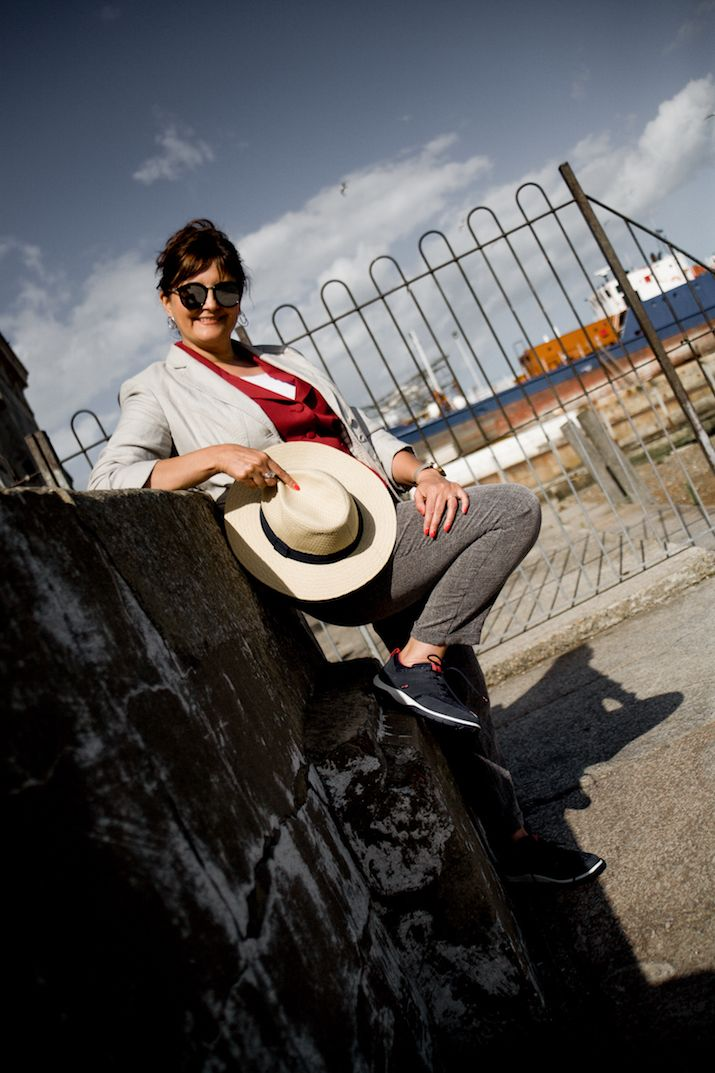 Casual to smart outfit for a Summer work meeting | grey lightweight trousers, cream linen jacket, orange waistcoat, strive trainers, fedora hat, white tee | What to wear over 50 | Barefaced Chic | A blog for women over 50