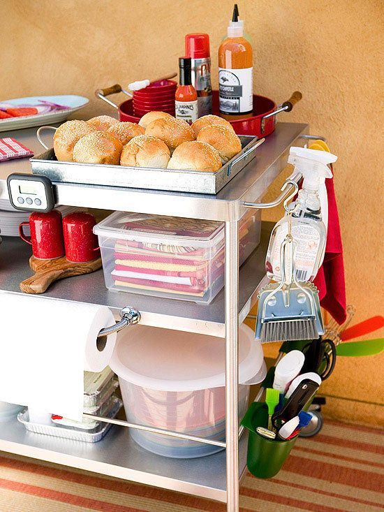 Ikea Flytta cart pimped out.  Note hooked cups on bottom bar, paper towel bar drilled in, magnetic tools.