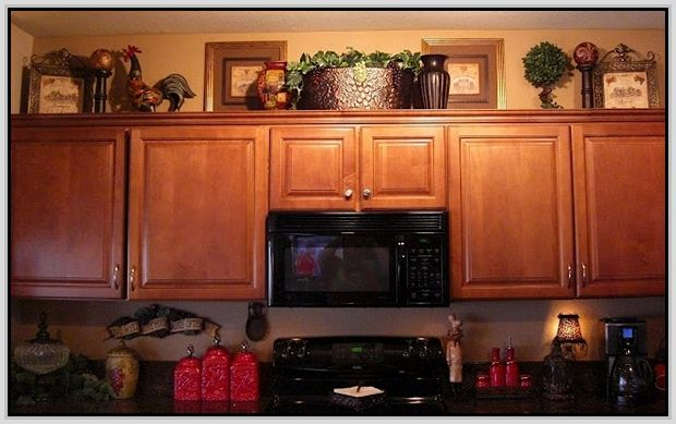 Decorating above cabinets in kitchen decorating above for Above cupboard decoration ideas