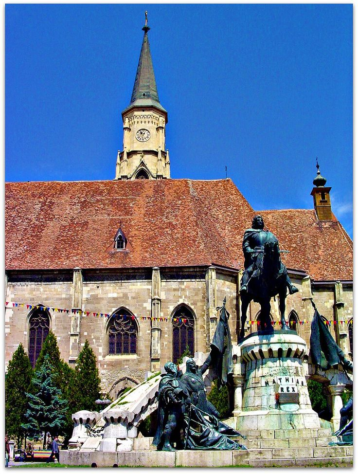 Corvin's statue by St. Michael's Church in Unirii Square; the church was built in the 14th century and named after the Archangel Michael, the patron saint of Cluj-Napoca. Corvin's Statue | Flickr - Photo Sharing!