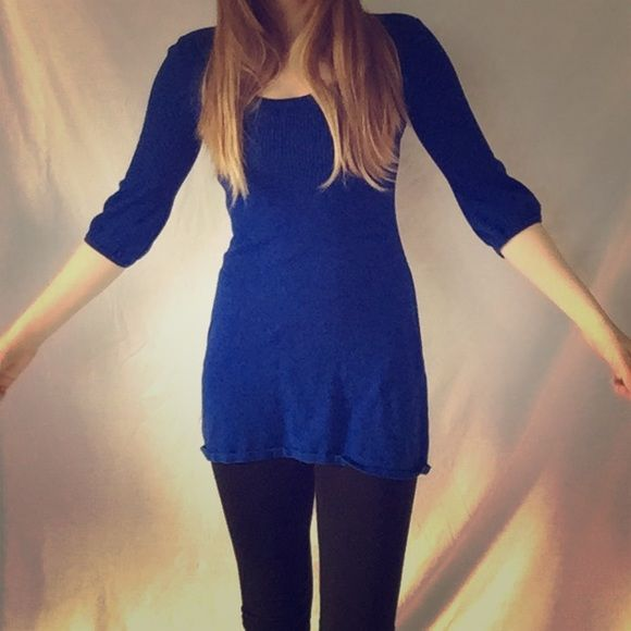 Blue winter dress. I call it a winter dress because the material is pretty thick and would be much too hot in the summer. This dress is in good condition and the blue is very vibrant. Dresses Midi