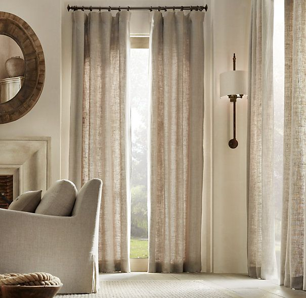 Restoration Hardware»Washed Belgian Linen»Washed Belgian Linen Drapery    Black curtain rods with neutral curtains.    Belgium's oldest and most honored mill looms our linen fabric from the finest native-grown flax, yielding the rich look and texture that only Belgian linen can impart. Repeated washing enhances the soft feel, creating a casual yet sophisticated look with an elegant drape.