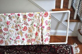This is my currentbaby gate:     It's too wide, too clunky, and just plain ugly.      Last week, while stalking one of my favorite sewing...