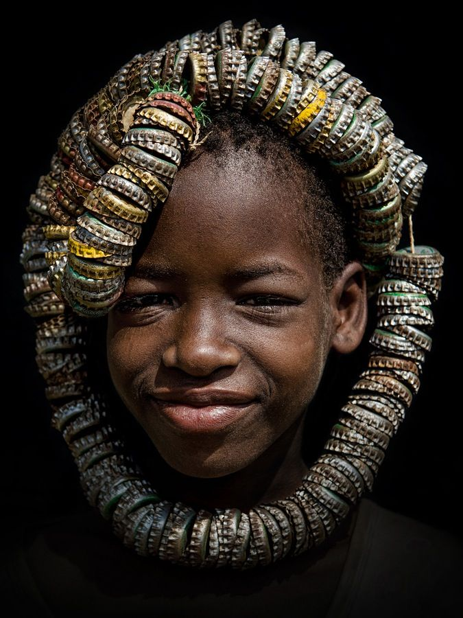 Africa | A Tsemai (Tsemay/Tsamai) girl wearing a unique headdress made of bottle caps. Near the town of Weyto, Omo Valley | ©Stefan Cruysberghs
