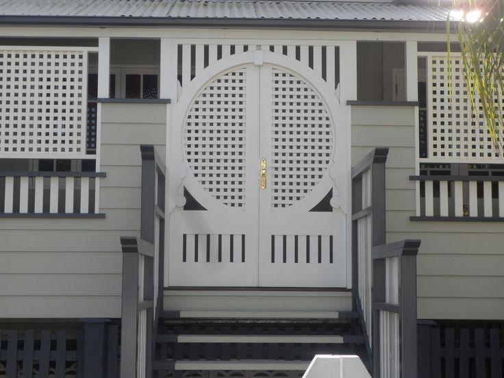( Bat Wing Doors )Lattice doorway & entry to a Queenslander