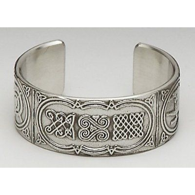 "Celtic Design Pewter Cuff Bracelet-Made in Ireland Mullingar Pewter. $45.00. Made in Ireland by Mullingar Pewter.. Features Celtic Knots and Weaves.. Bracelet is approximately 1"" wide."