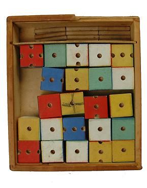 A rare, 1920s Bauhaus era, child's building toy. The toy features 23 cubes and 11 wooden sticks with which a child could have countless hours exercising his or her imagination. The toy's design, especially coloring of blocks and pedagogic, fits perfectly in the Bauhaus ideal and in the spirit of Alma Siedhoff-Buscher . Each cube measures 1.5 inches square.