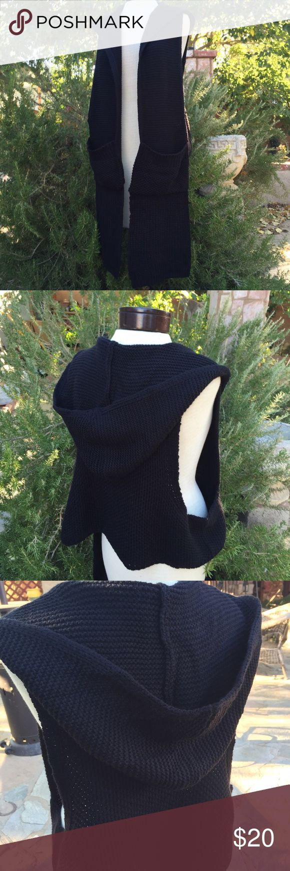 Hooded Rug Sweater Very unique design with long sides in the front. Big pockets. Excellent condition. Double Zero Sweaters Shrugs & Ponchos