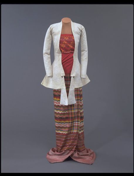 Yinzi or tabet 1885 This garment would have been worn as a breast cloth, forming an ensemble, as shown, with a wrap skirt and jacket. The garment dates from the reign of King Thibaw (r. 1878-1885), the last ruler of the Konbaung dynasty. It was found in the apartment of Queen Supayalat, the chief queen of King Thibaw, by the donor's husband, Colonel Pollard, who was a member of the British force that annexed upper Burma in 1885.