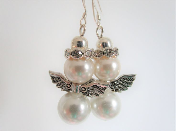 Be prepared for Christmas time and parties - these angel earrings are perfect for the festive season! White glass bead bodies, cream glass bead heads, Tibetan silver wings approx 23mm wide, silver plated rhinestone crowns, silver plated ear wires, headpins, and spacer beads - newly listed in my Etsy shop https://www.etsy.com/uk/shop/AngelsandElfsDotCom  ... I can make angel earrings in other colours