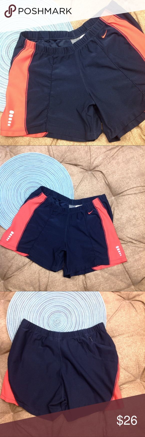 Nike Dri Fit Shorts SZ Small 4-6 Blue Orange Great condition Nike Dri Fit Shorts SZ Small 4-6 Blue Orange zip back pocket poly/spandex 13 inches across elastic waist 4 inch inseam 9 1/2 inch rise Nike Shorts