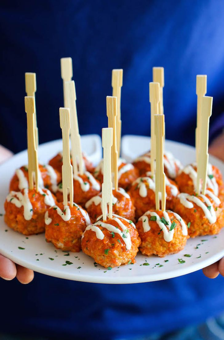 Slow-Cooker Buffalo Chicken Meatballs: Stick a skewer in these buffalo chicken meatballs, and they instantly become cocktail-party- (or game-day-) ready.