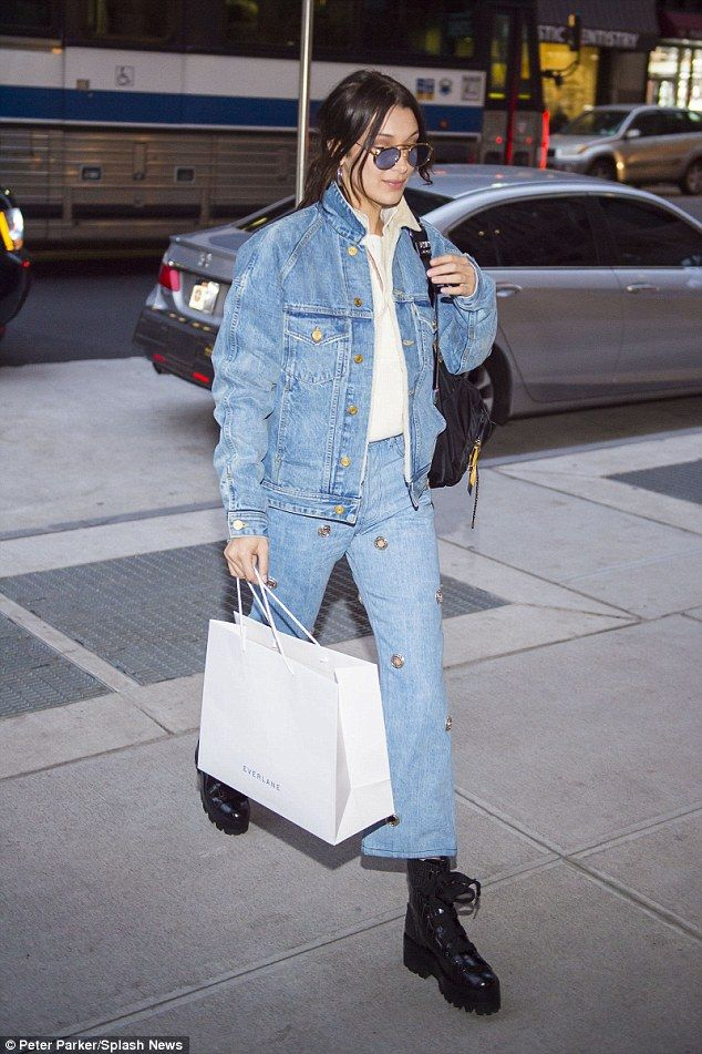 Double denim: Bella Hadid, 21 looked young and trendy as she strolled the streets of New York on Tuesday wearing a denim outfit with metal details and army style black boots