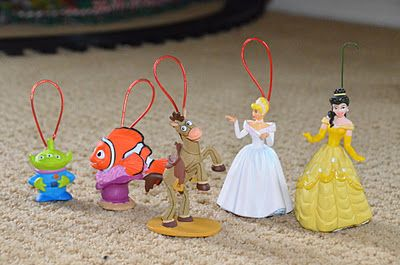 turn your children's toys into ornaments- great idea for when your kids are older. Look back and see what they played with.