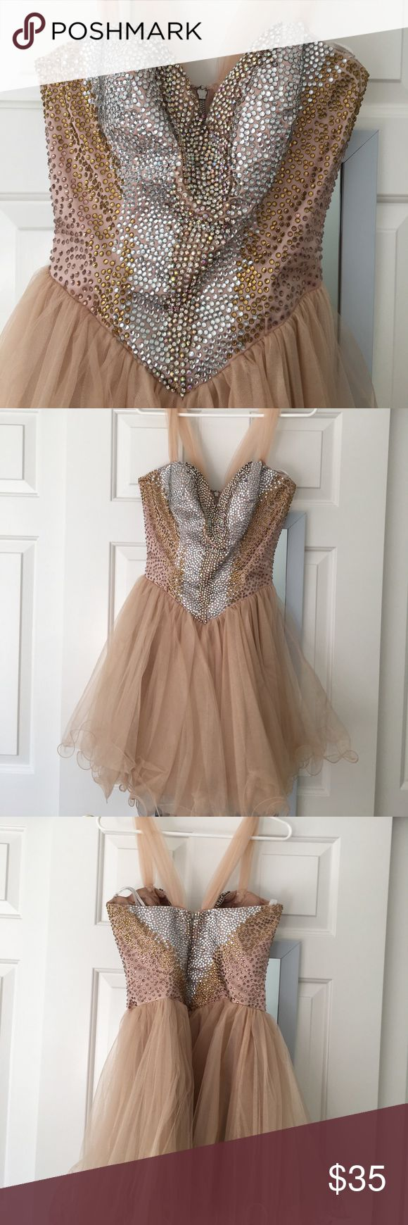 Sherri Hill cocktail dress size 8 Beautiful Sherri Hill dress worn by my daughter to a junior dance.  Sheer straps added and plunge bust closed to comply with dress code.  Both can be removed.  Only two rose gold rhinestones missing and they are on the side and back.  Lots of glitz.  Priced very well for the one and done dress wearer. Sherri Hill Dresses Mini